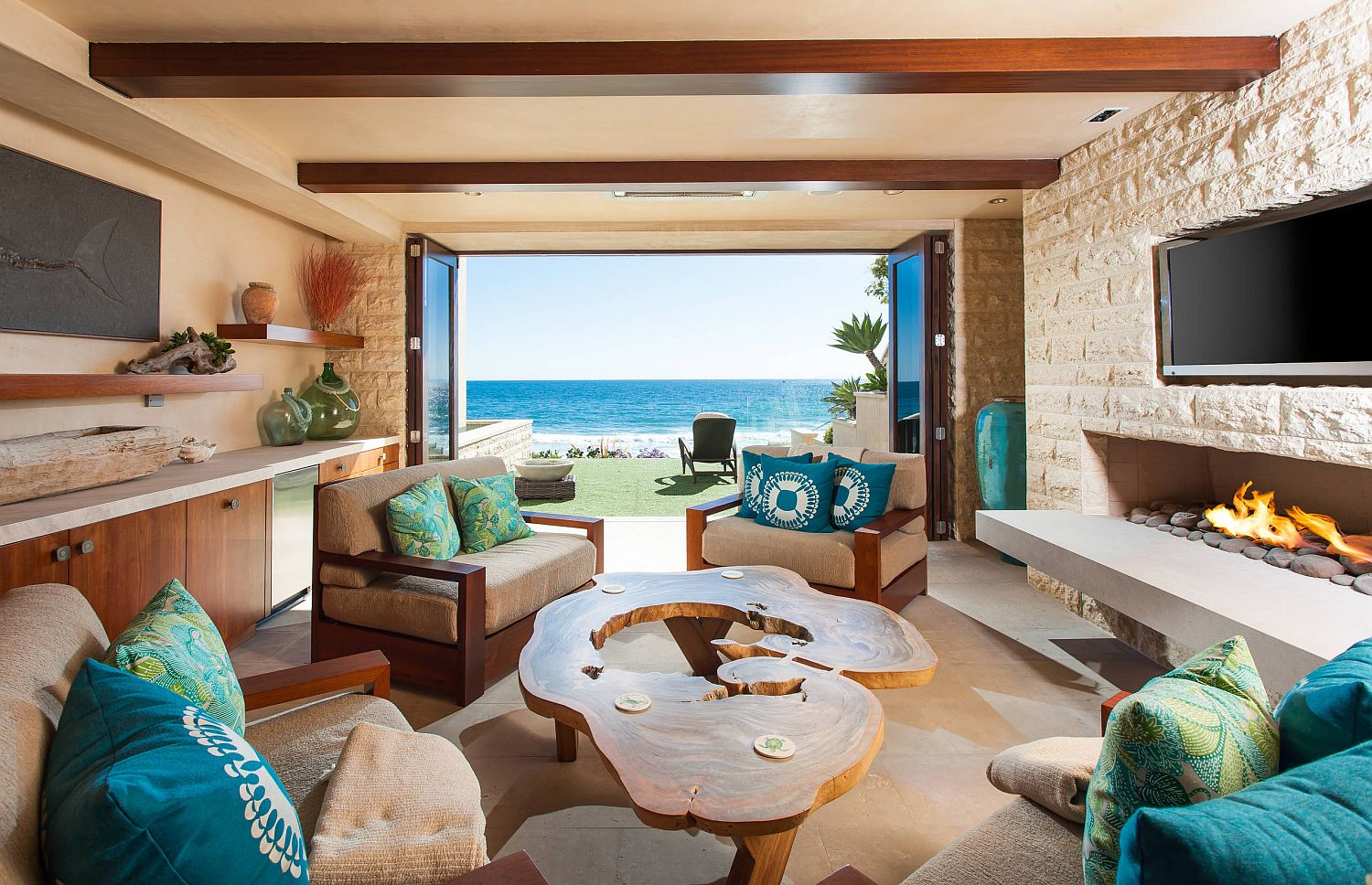 View of the ocean from the tropical style living room