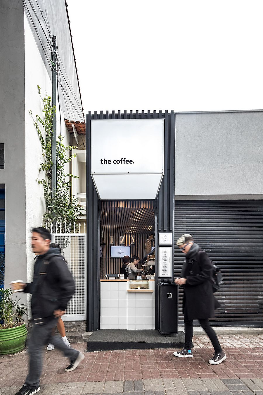 White coffee shop exterior with black thrown into the mix