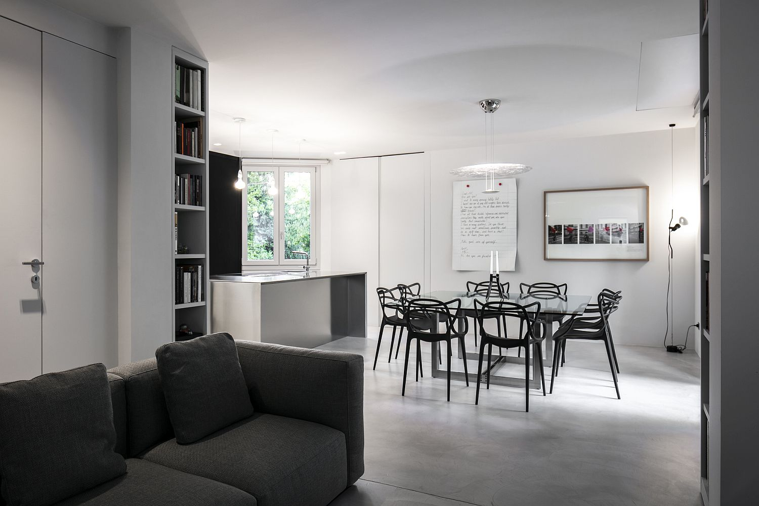 White, shades of gray and black combined to create a fabulous contemporary living room