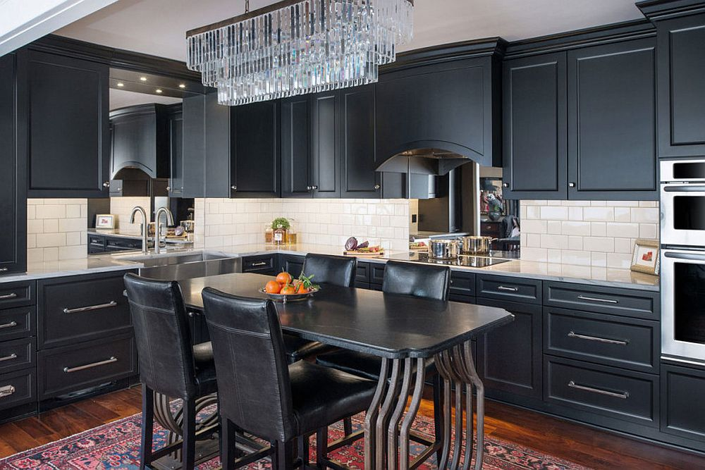 White-subway-tiles-stand-in-contrast-to-the-black-used-exensively-in-the-black-kitchen