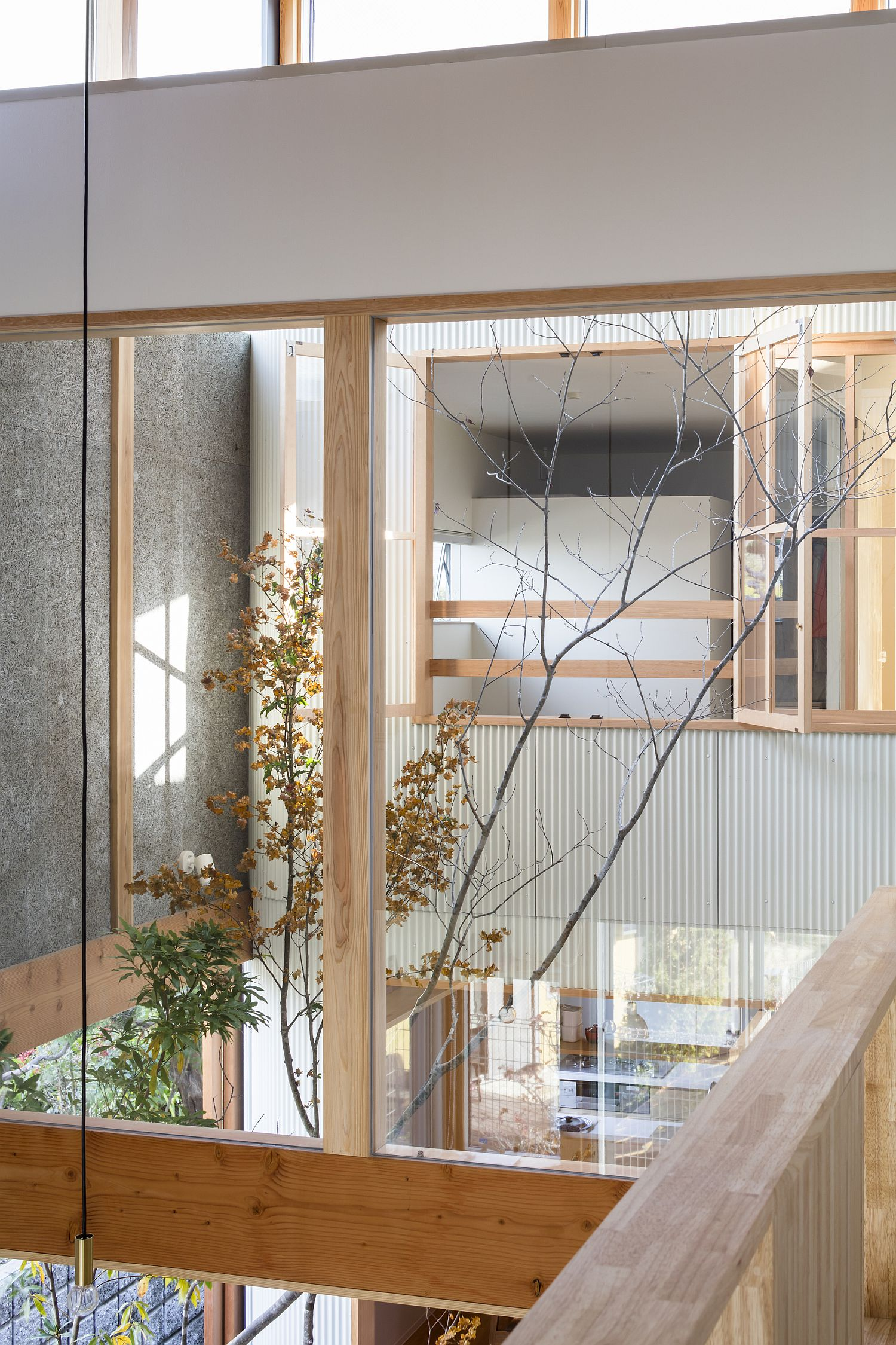 White, wood and glass create a cool interior inside the Japanese home
