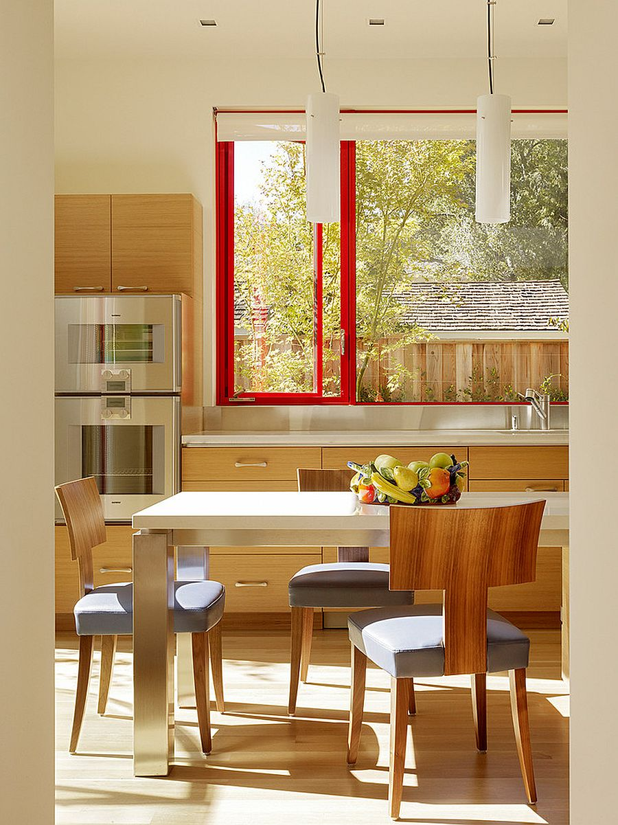Window frames bring a splash of red to the kitchen