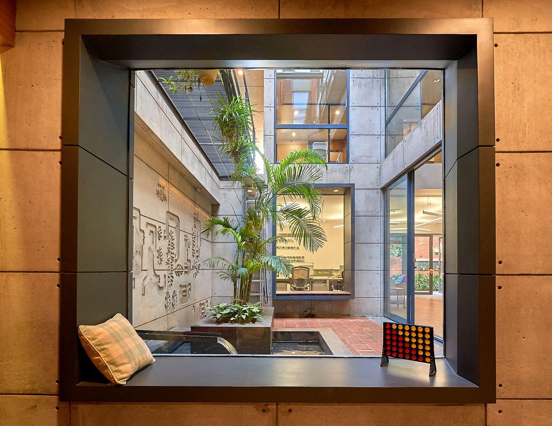 Window seat that overlooks the sunken courtyard along with the tea room