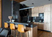 Wood-and-black-small-kitchen-with-stylish-bar-stools-and-smart-lighting-217x155