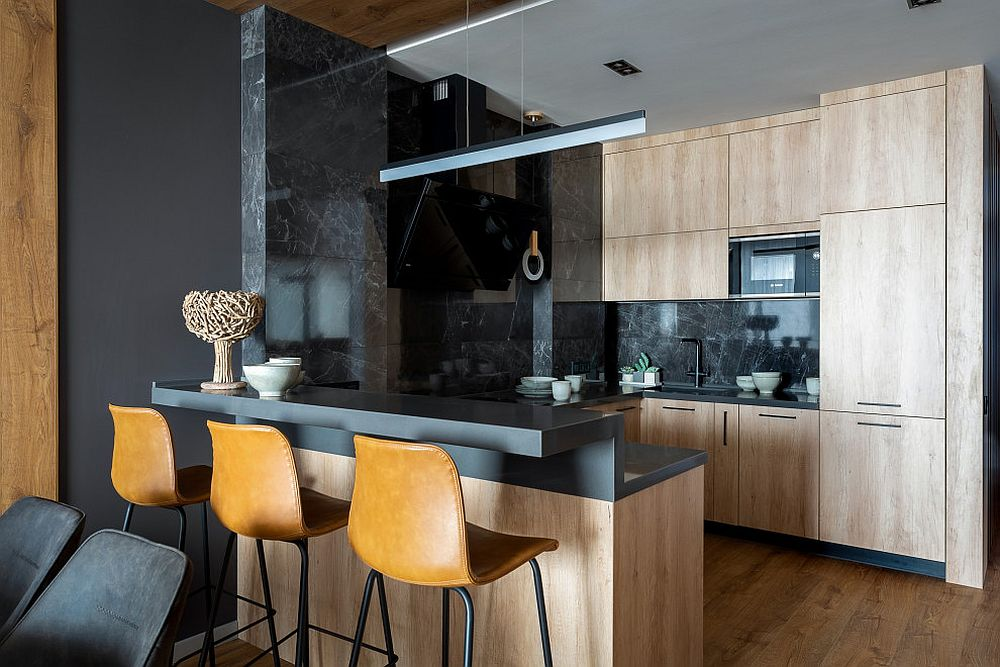 Wood-and-black-small-kitchen-with-stylish-bar-stools-and-smart-lighting
