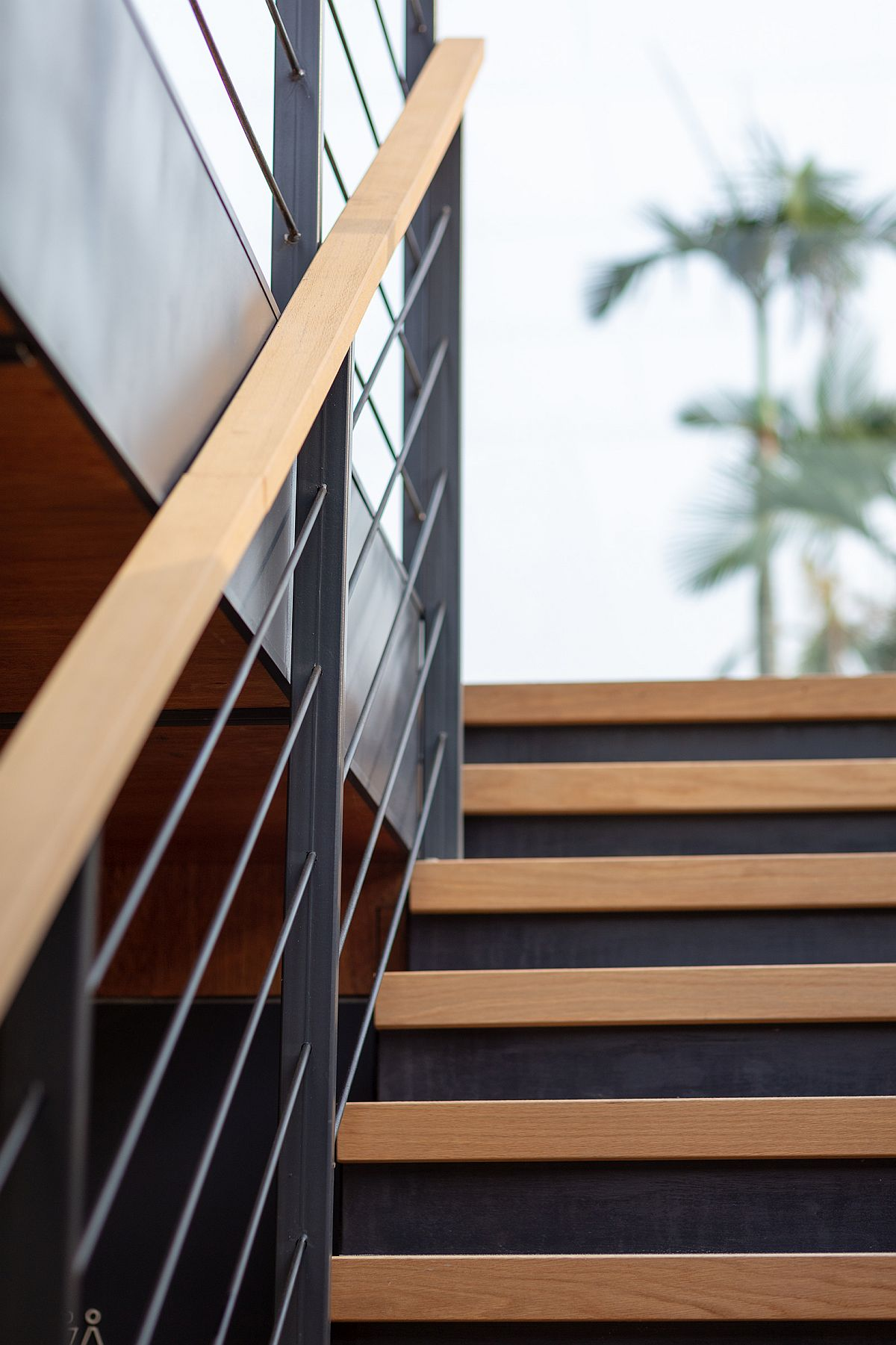 Wood and steel staircase inside the marketing suite feels simple and industrial