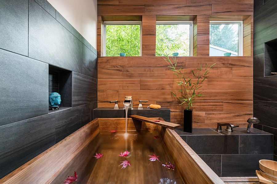 Wood, black stone and white combined ever so beautifully in the bathroom
