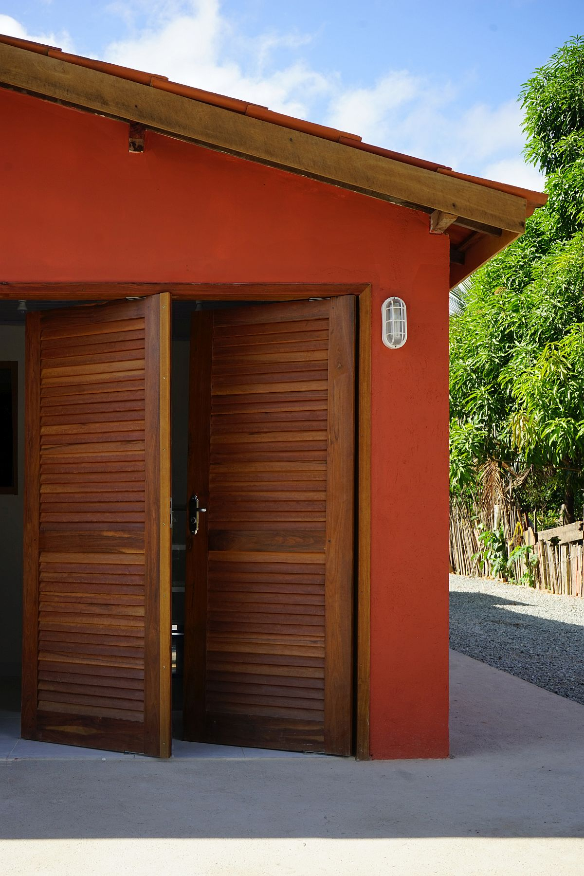 Wooden shutters coupled with earthen nd ceramic finishes