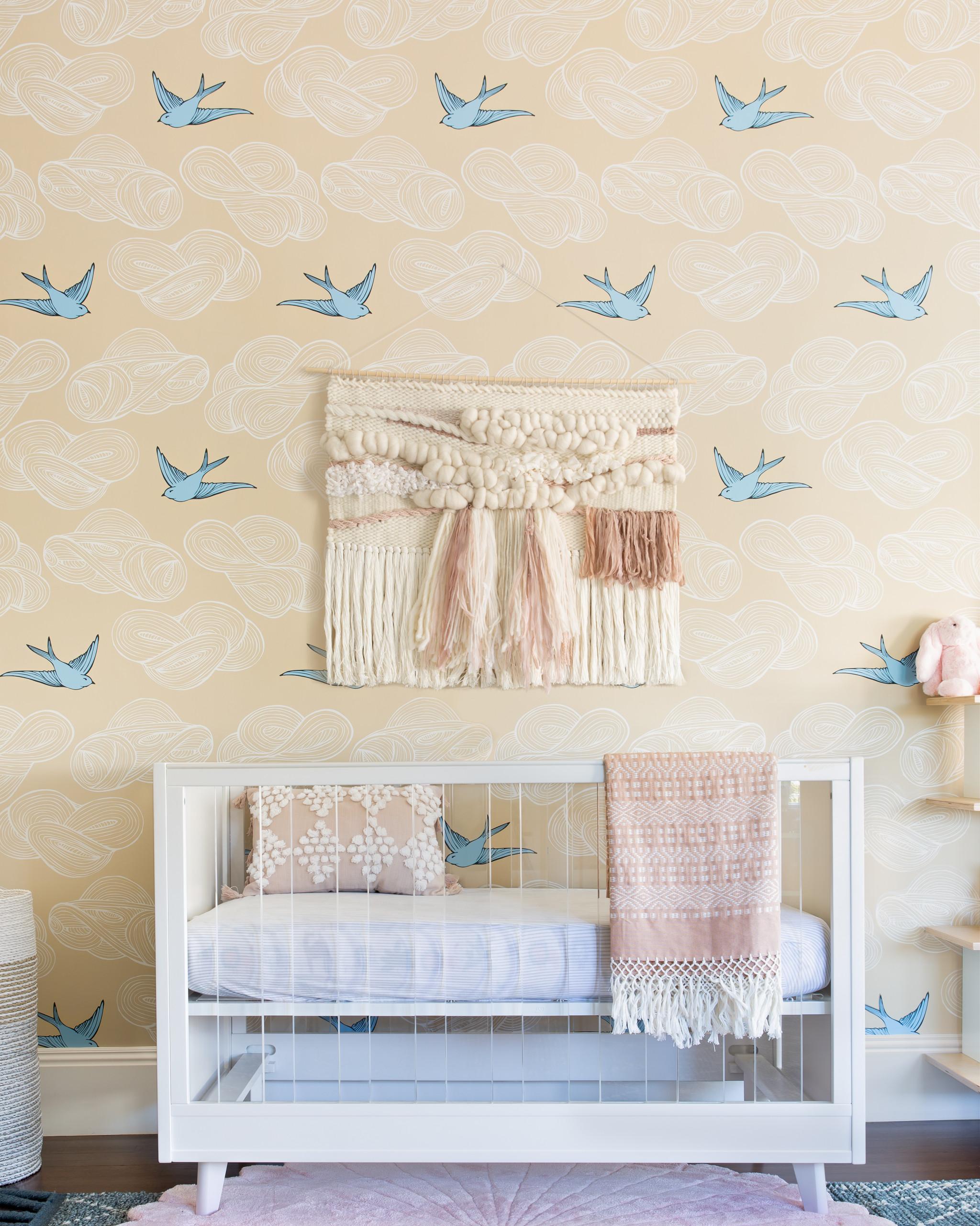 A popular wallpaper choice with bird print for the smart modern nursery