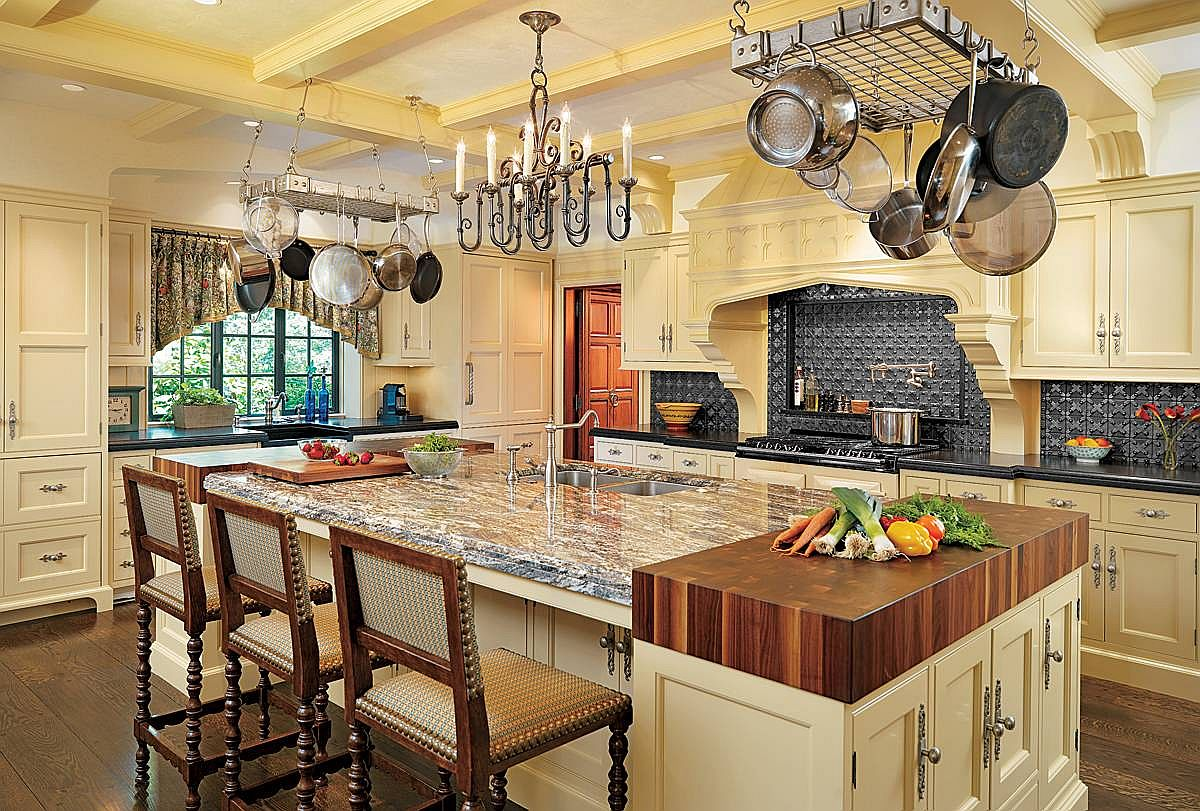 Add the butcher block to the large kitchen island with stone countertop and ample shelf space