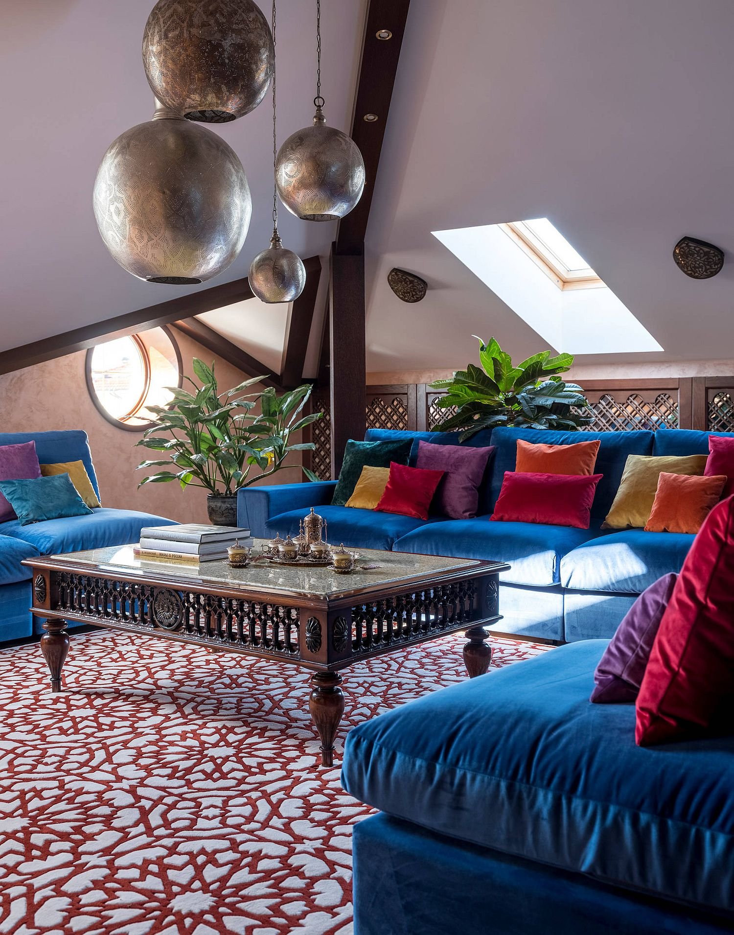 Attic boho chic living room drenched in plenty of bright color