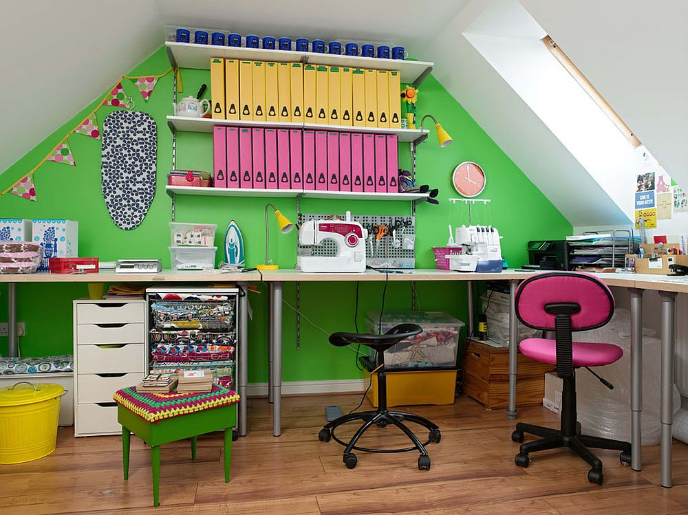 Attic home office with a striking green accent walls and brilliant pops of yellow and pink all around!