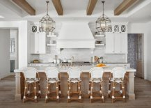 Bar-stools-floor-and-ceiling-beams-add-woodsy-warmth-to-the-kitchen-74979-217x155