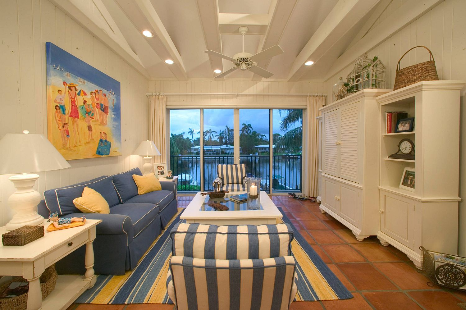 Beach-style-living-room-in-white-and-blue-with-terracotta-floor-55662
