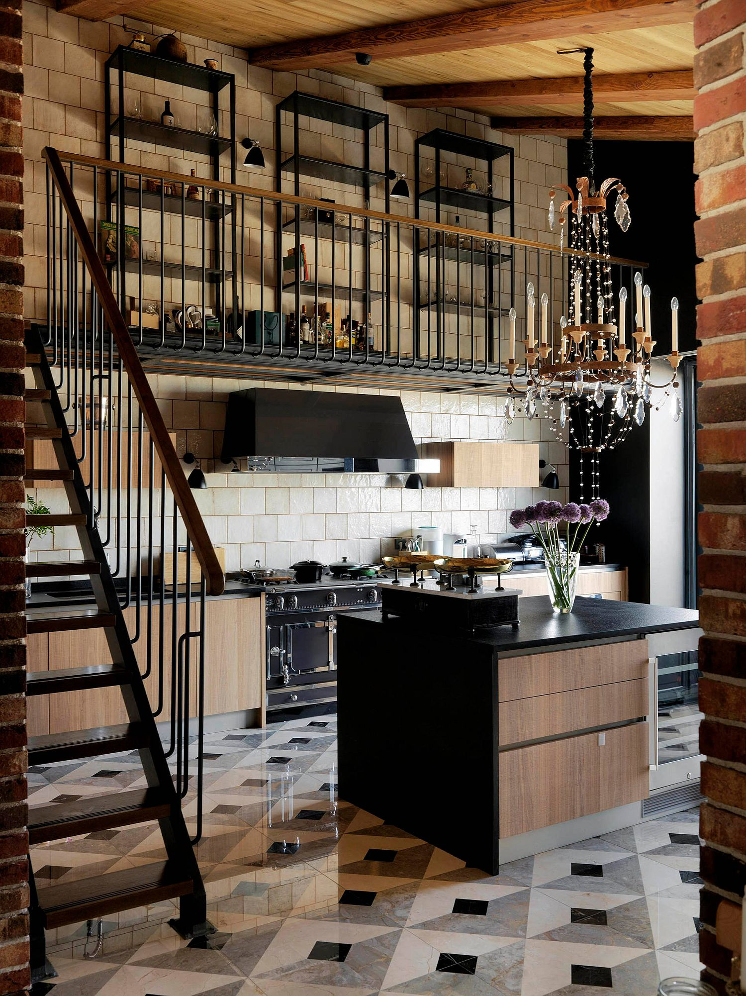 Beautiful industrial style kitchen full of textural contrast, black appliances and dark countertops