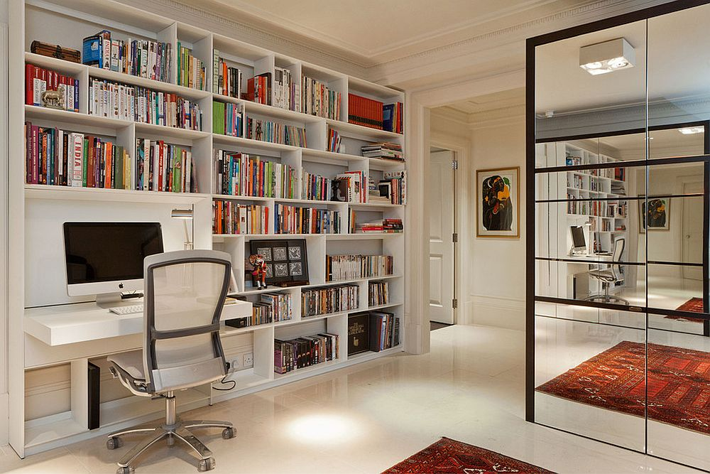 Beautiful modern-industrial home office in white with ample shelf space and a folding desk