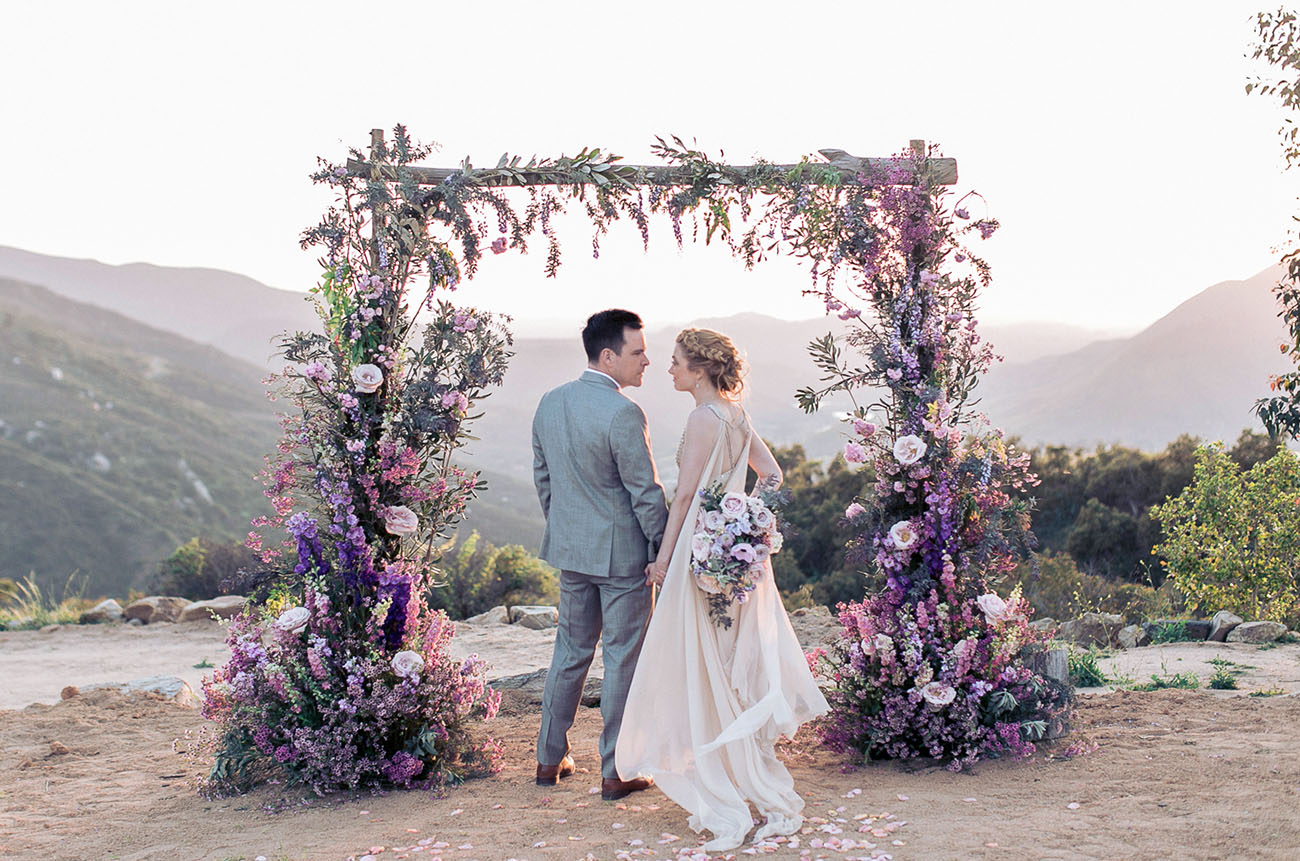 Beautiful wedding arch with berry tones
