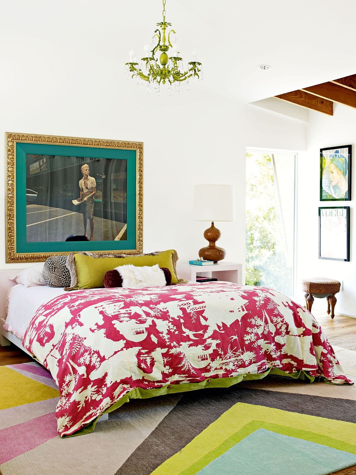 Bedding, rug and accent pillows add color to the eclectic neutral bedroom