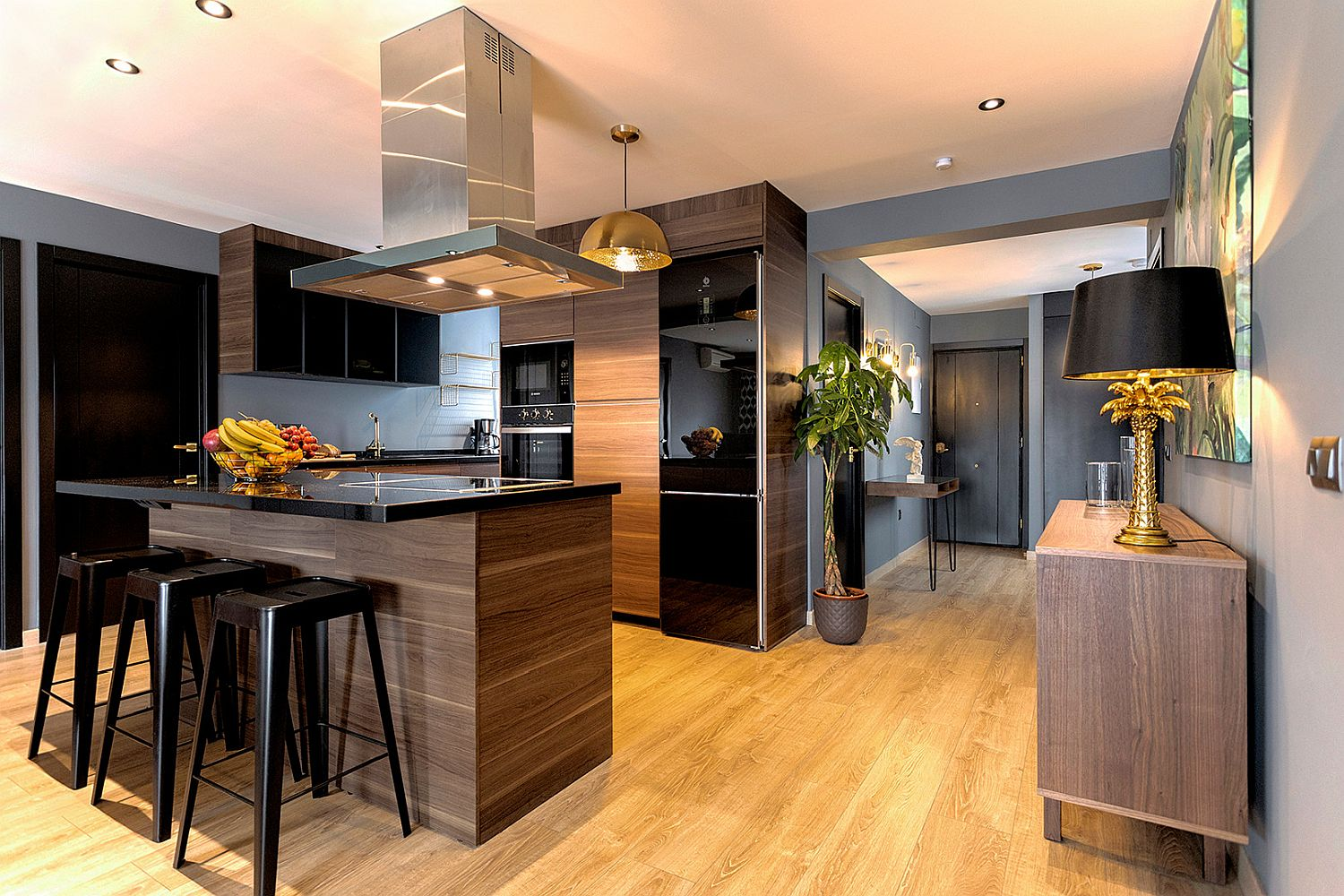 Black appliances add gloss and class to the contemporary kitchen in wood and white