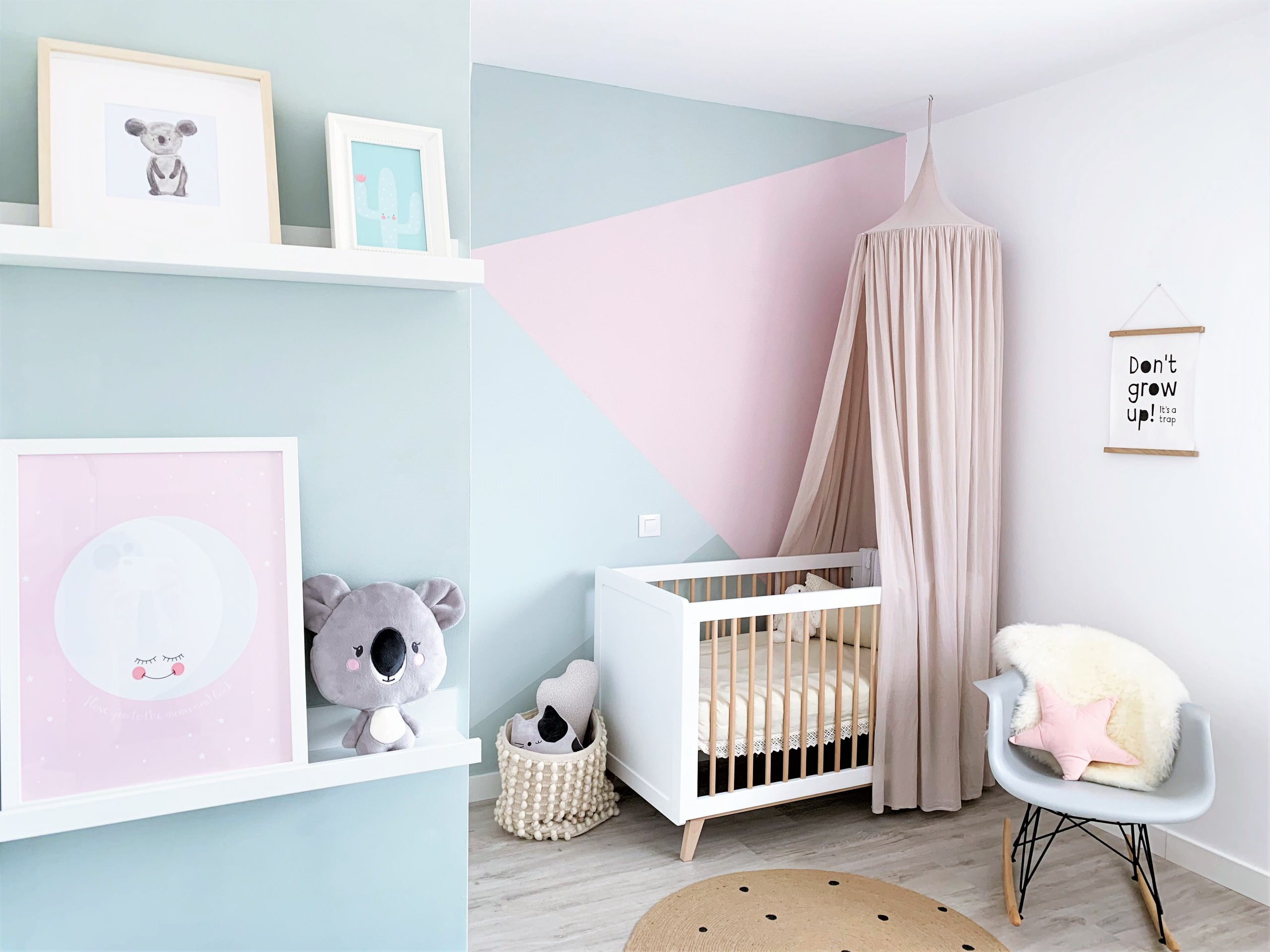 Blocks of pastel pink and blue make a big difference to the backdrop of this modern nursery