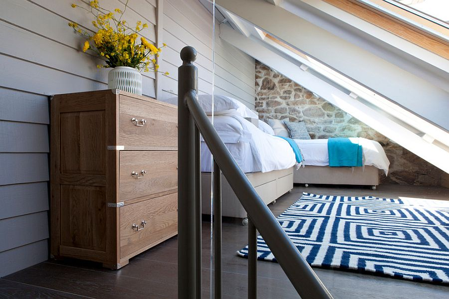 Blue and white work just great in the tiny attic bedroom with beach style