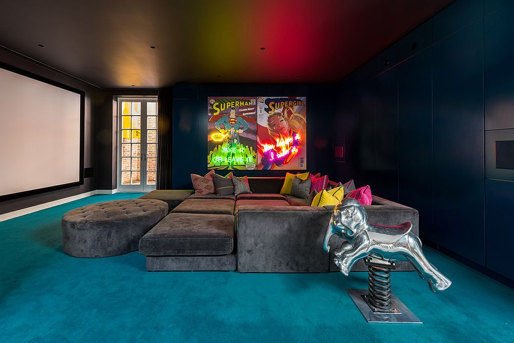 Blue carpet on the floor brings brightness to the basement eclectic home theater