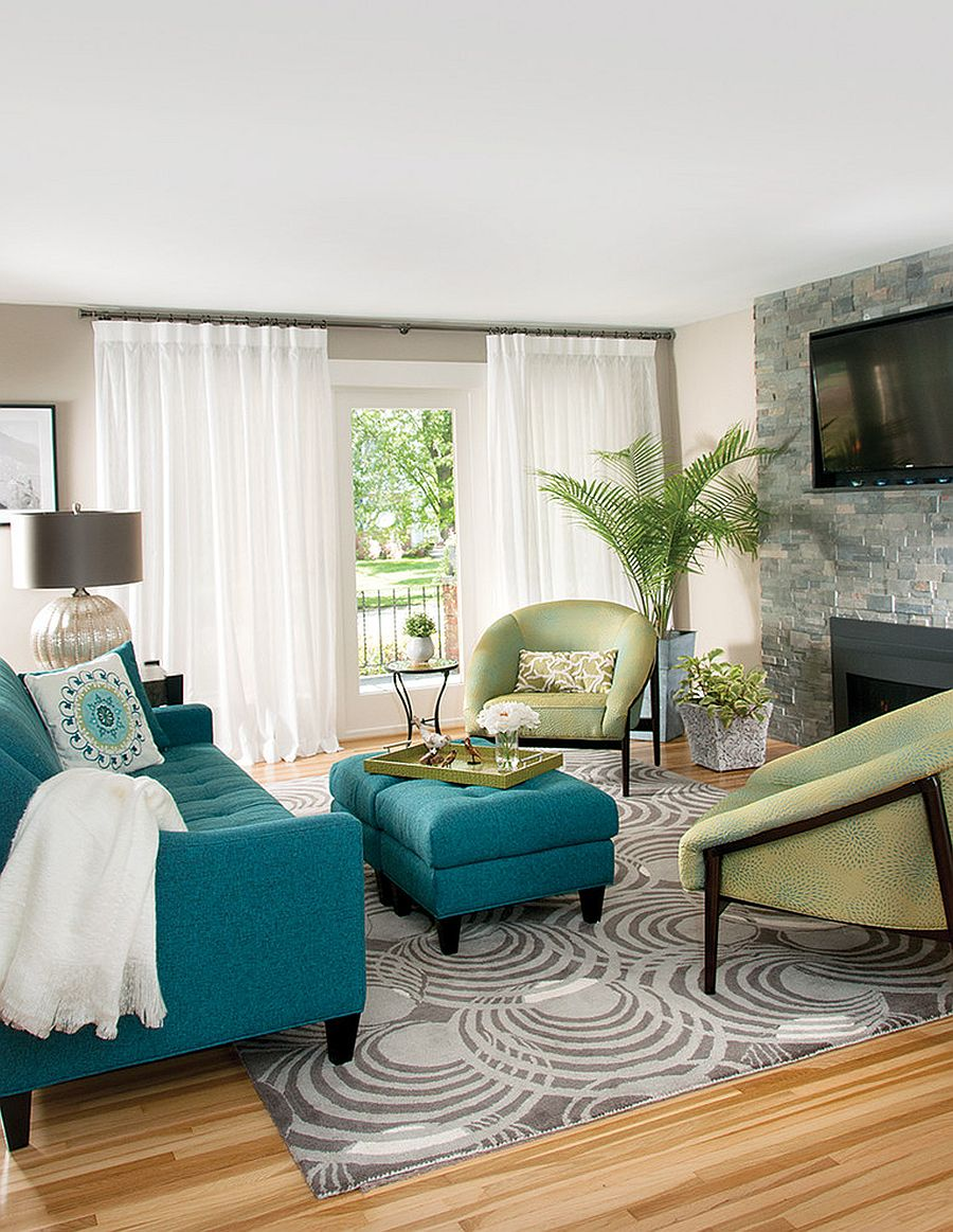 Blue-couch-and-light-green-club-chairs-enliven-the-white-living-room-54125