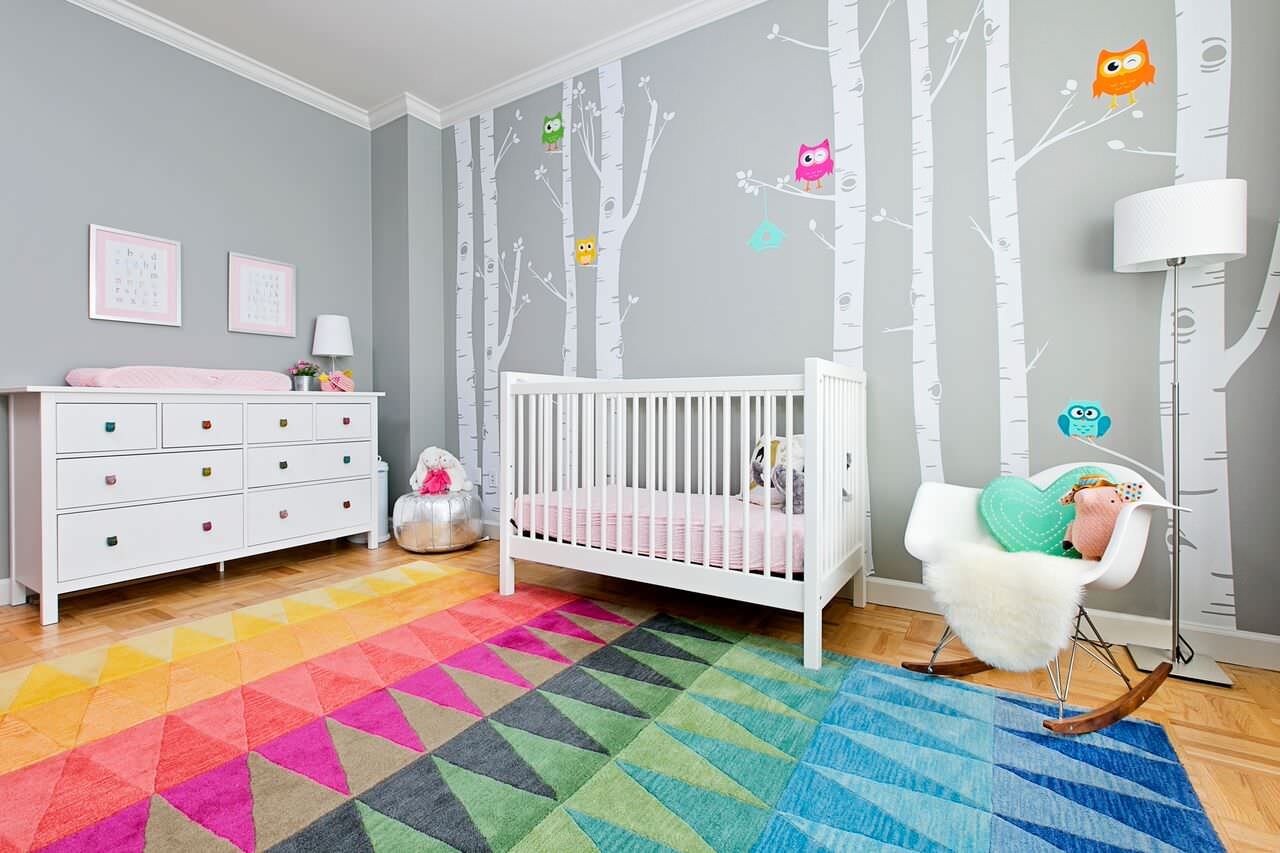 Brilliant multi-colored rug for the modern nursery with walls in gray