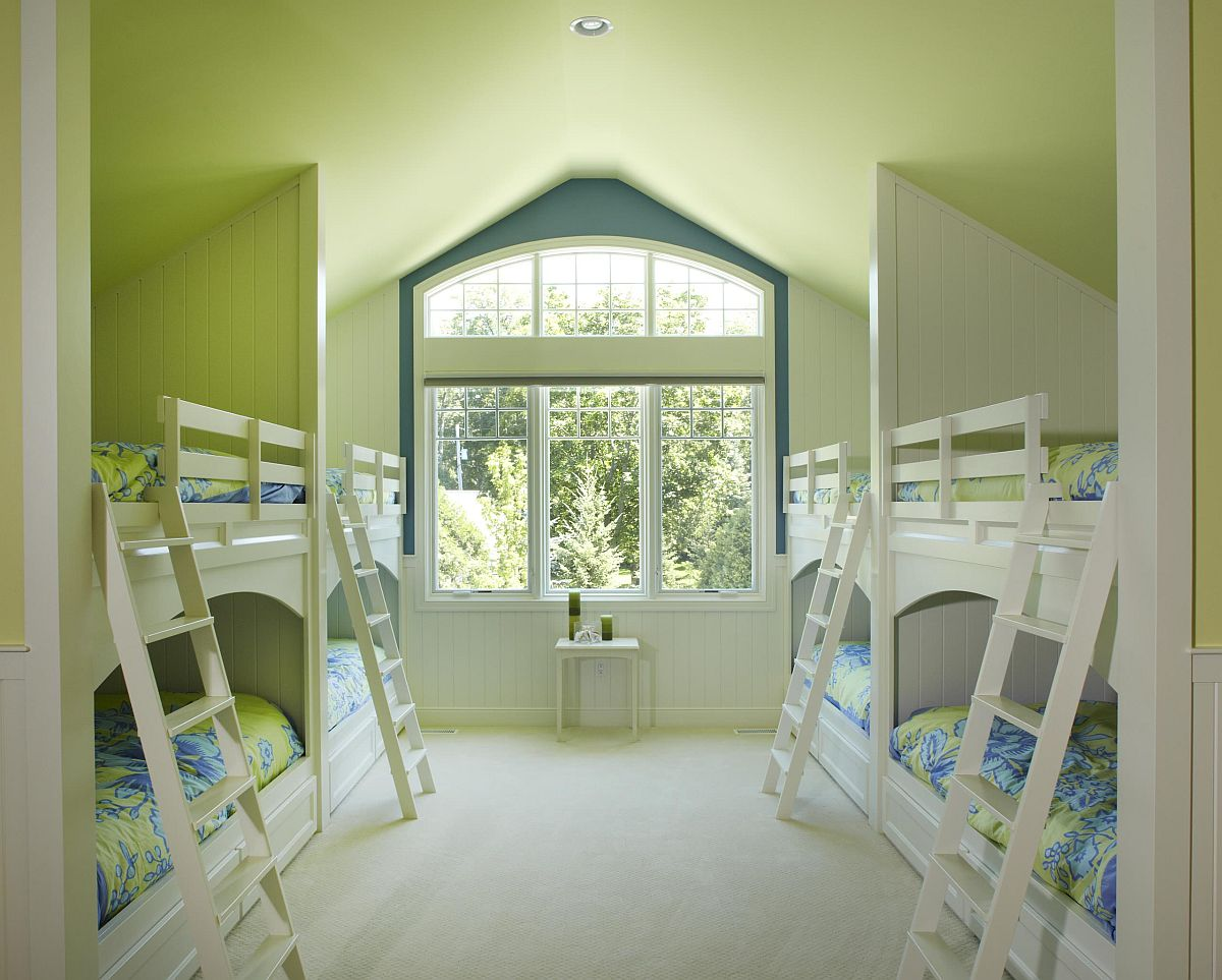Bunk beds in the attic bedroom save space while making it easy to host guests