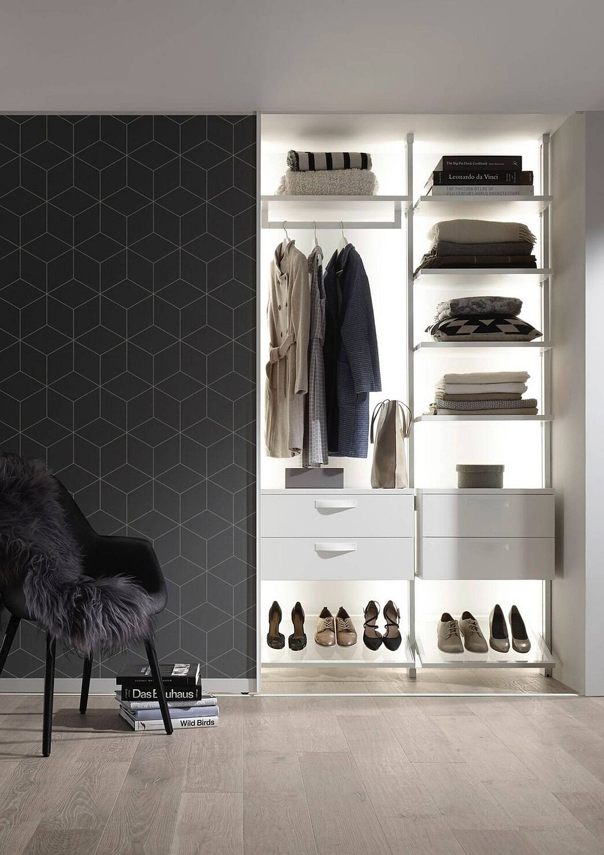 Chic and gorgeously-lit bedroom wardrobe is perfectly designed to meet the needs of the homeowner