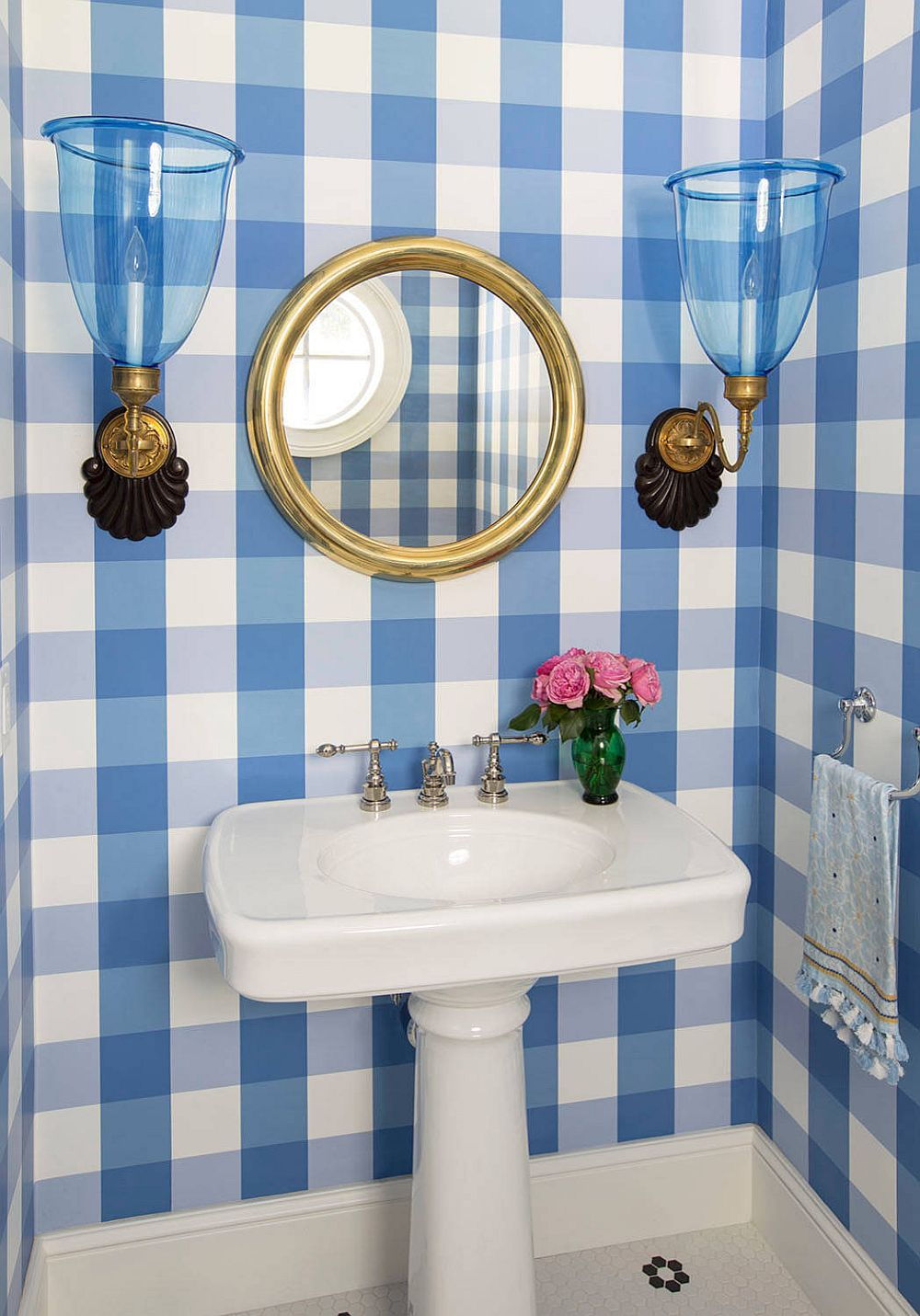 Classic beach style powder room with checkered pattern on walls that steals the show