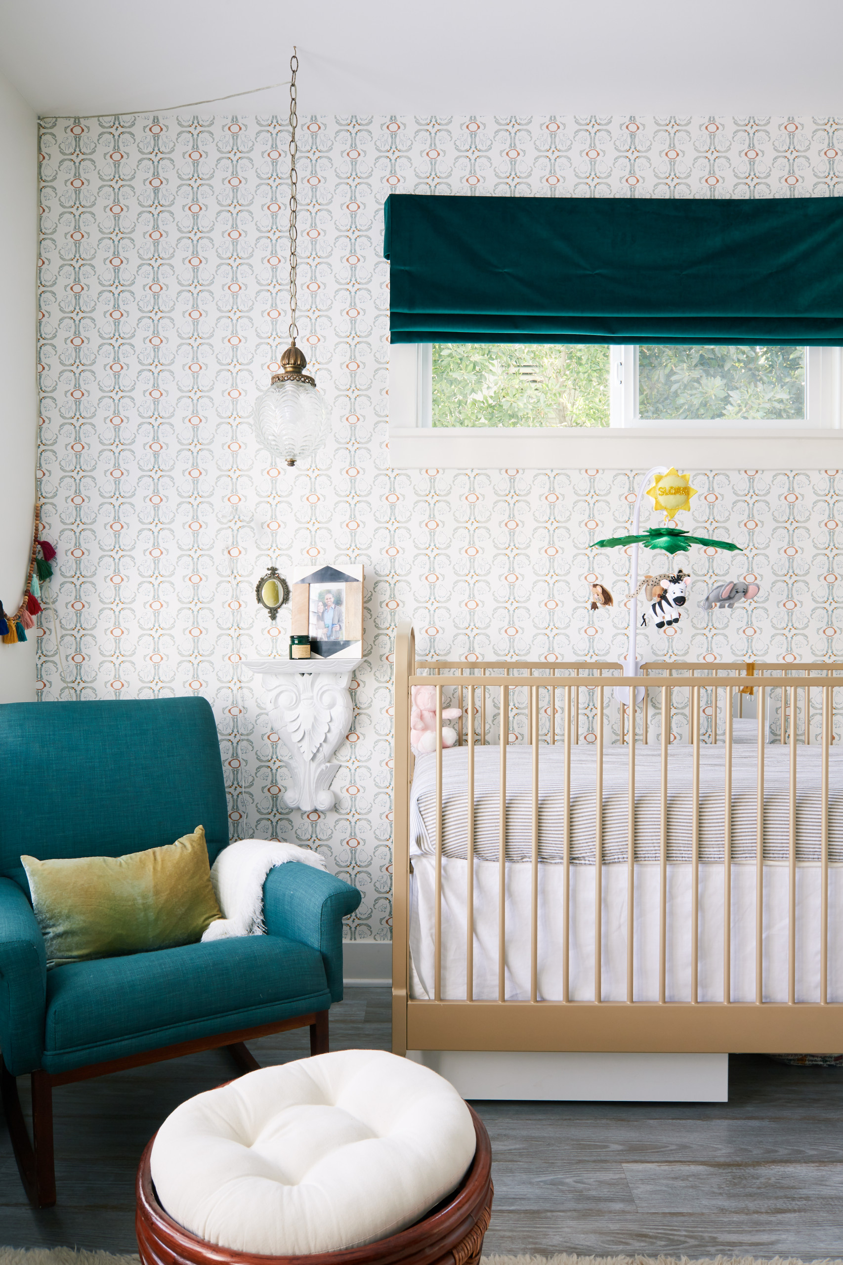 Combining a hint of color with a serene backdrop in the modern nursery