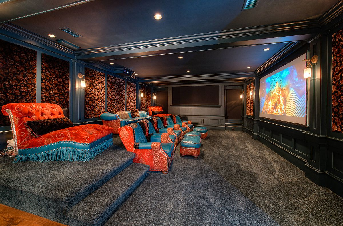 Comfortable seating in blue and orange for the spacious home theater that is filled with color