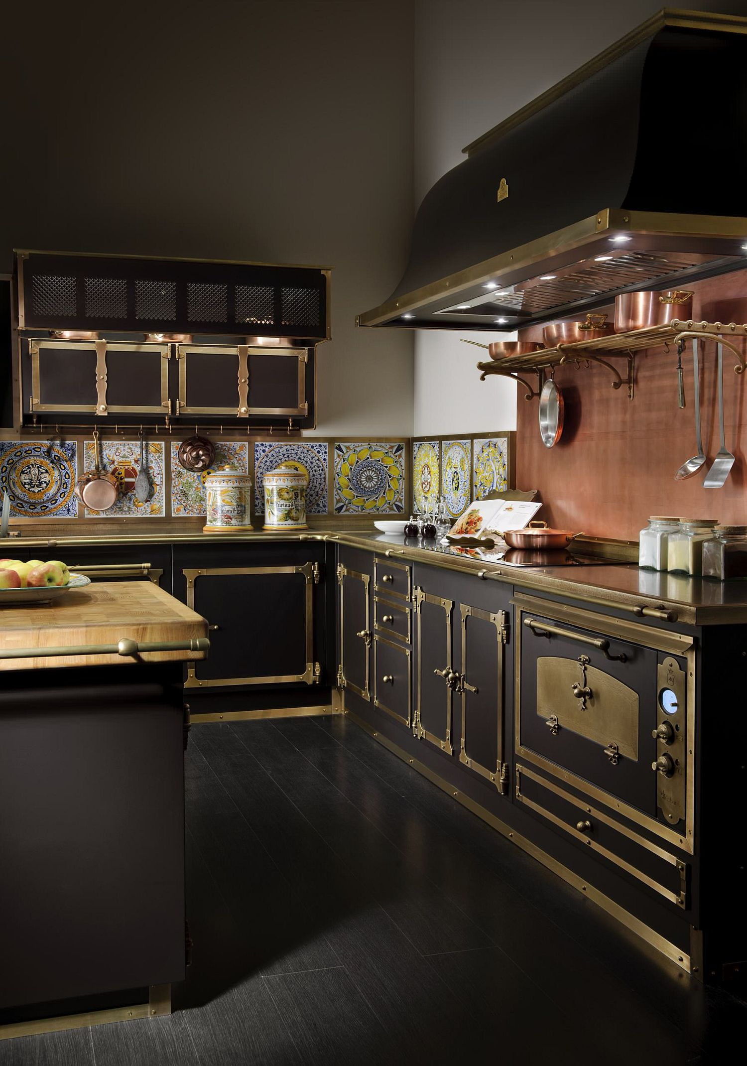 Copper and black custom kitchen range shapes this cool modern Victorian kitchen