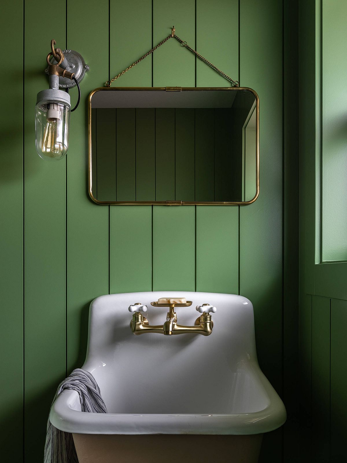 Cottage-style powder room with fabulous green walls and white sink