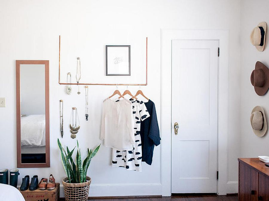 Crates, copper pipes and other DIY creations replace the traditional closet in this tiny bedroom