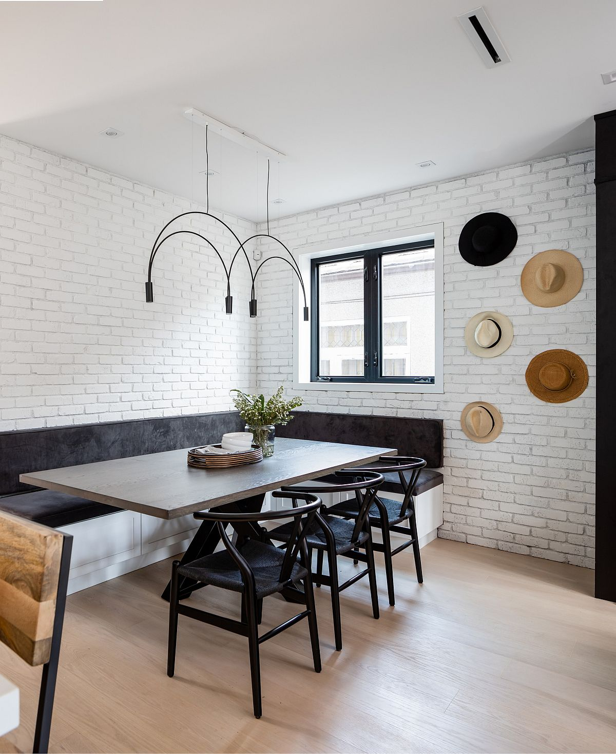 Custom-corner-banquette-seat-coupled-with-stylish-chairs-bring-black-to-the-dining-room-16436