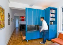 Custom-metallic-wall-in-blue-inside-the-apartment-multi-tasks-and-morphs-into-a-variety-of-decor-pieces-68027-217x155