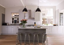 Dark-pendants-add-contrast-to-the-kitchen-while-the-wooden-floors-provide-visual-warmth-44621-217x155
