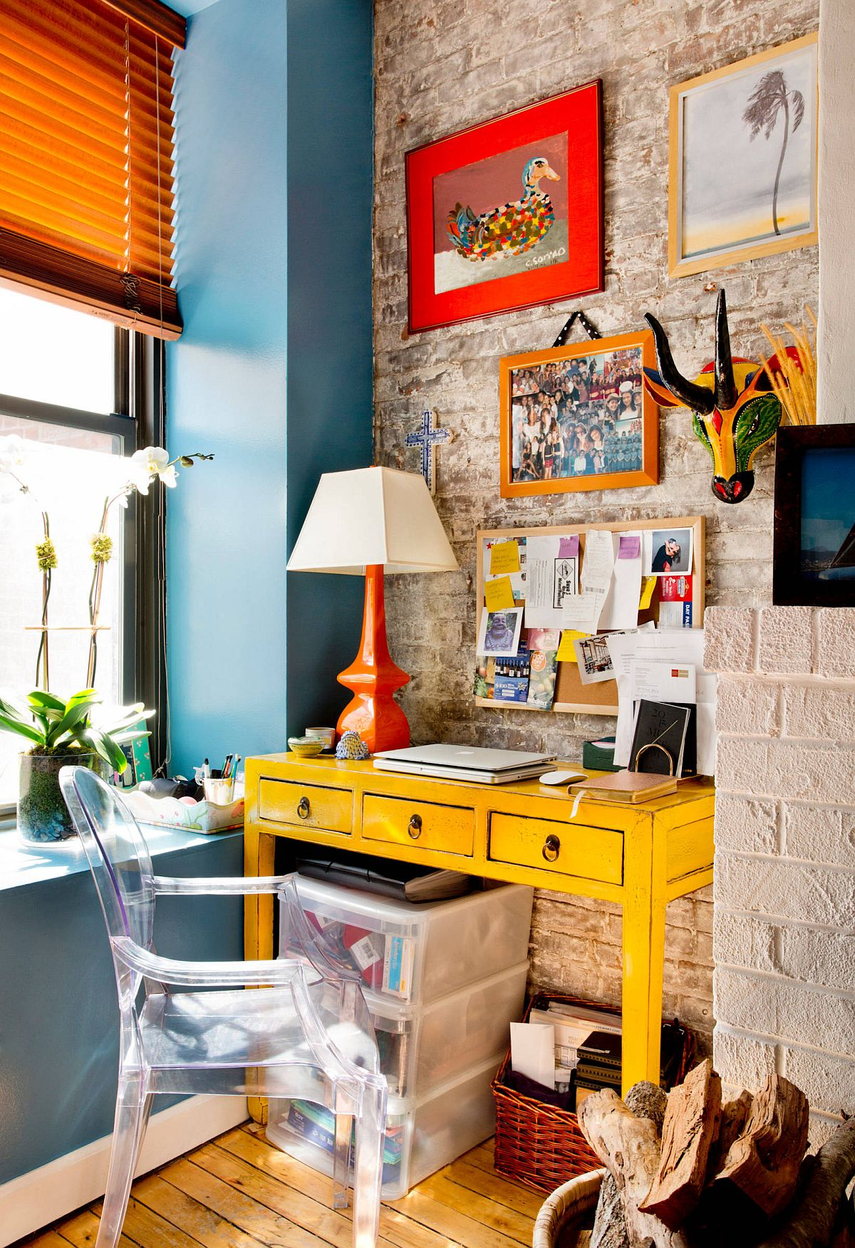Eclectic mix of fabulous yellow desk and bright orange table lamp inside modern New York home office