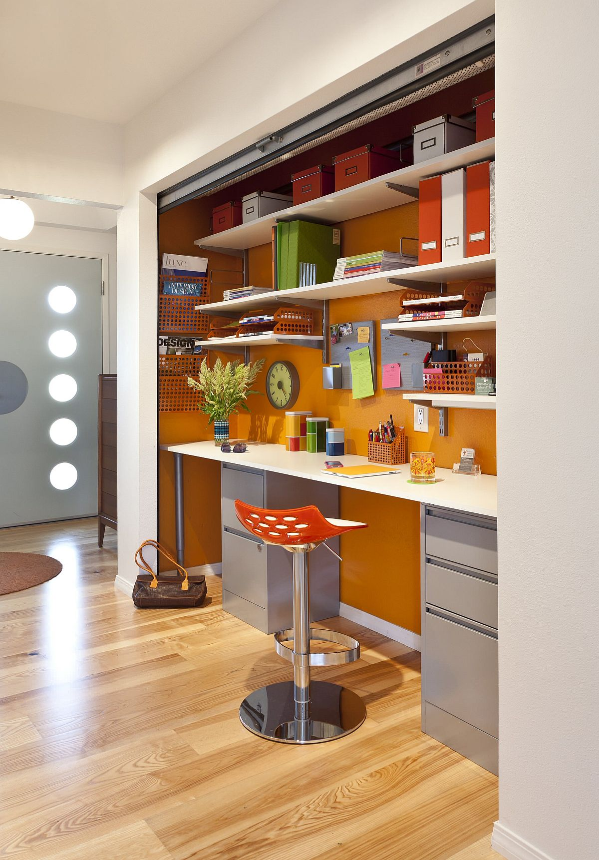 Exquisite orange home office feels refreshing and contemporary with a touch of quirkiness