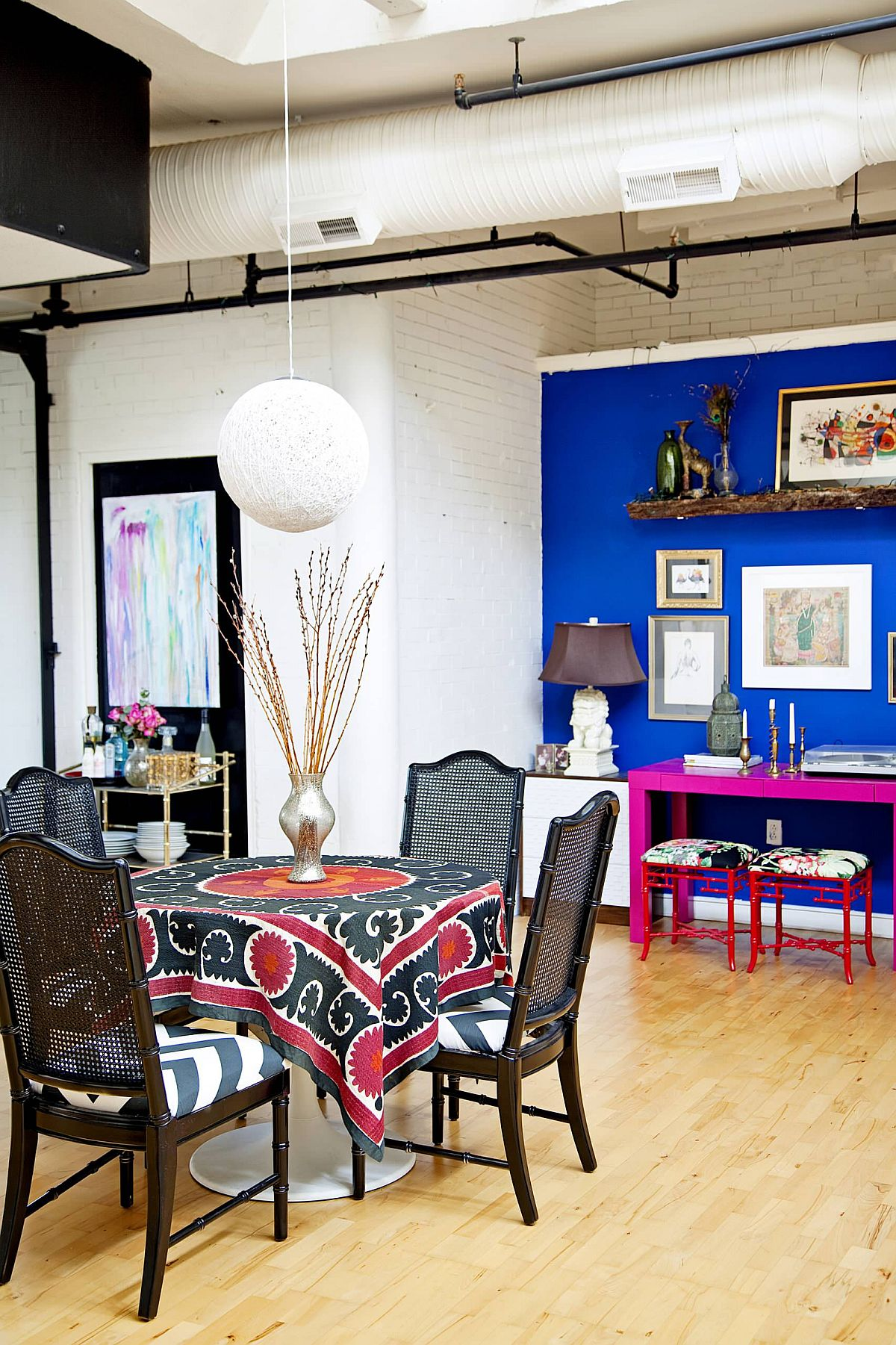 Eye-catching blend of brilliant blue and hot pink create a fabulous corner workstation in he dining room
