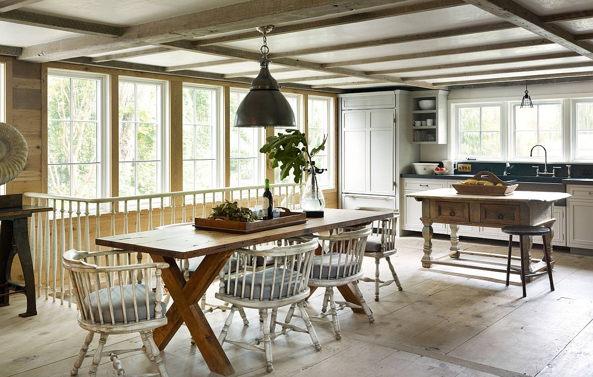 Farmhouse style eat-in kitchen with low ceiling and gorgeous lighting