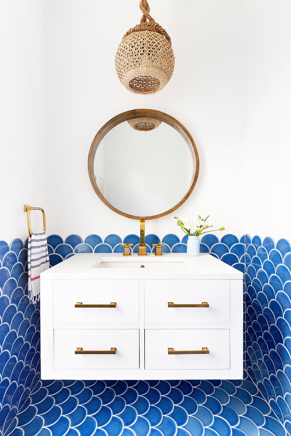 Fish scale tile in blue for the tylish beach style powder room in white