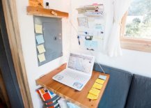Folding-desk-in-the-ultra-tiny-apartment-living-room-gives-felxibility-with-space-savvy-design-93066-217x155