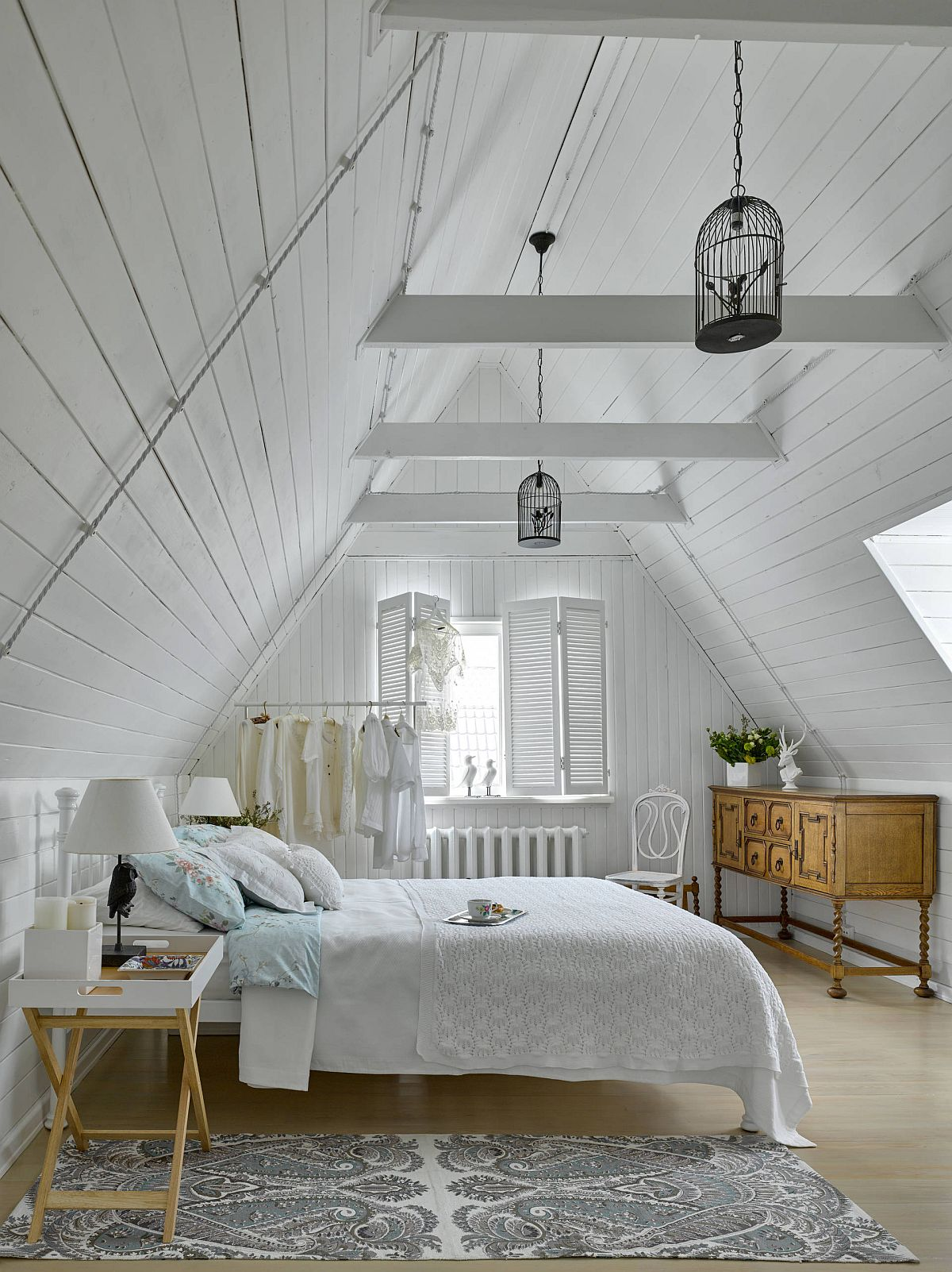 Gentle wooden accents bring contrast to an otherwise beautiful white attic bedroom with shabby chic style