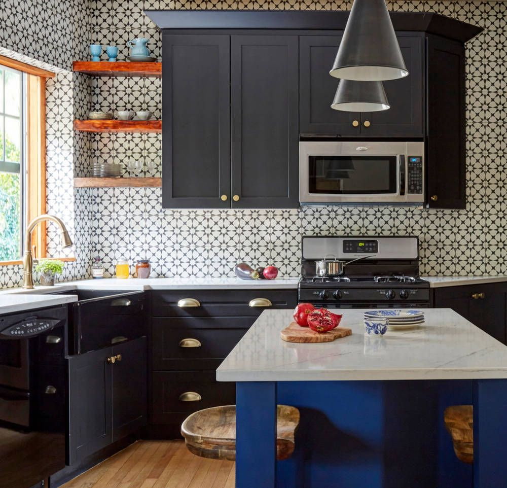 Glossy black appliances fit into a colorful kitchen with ease