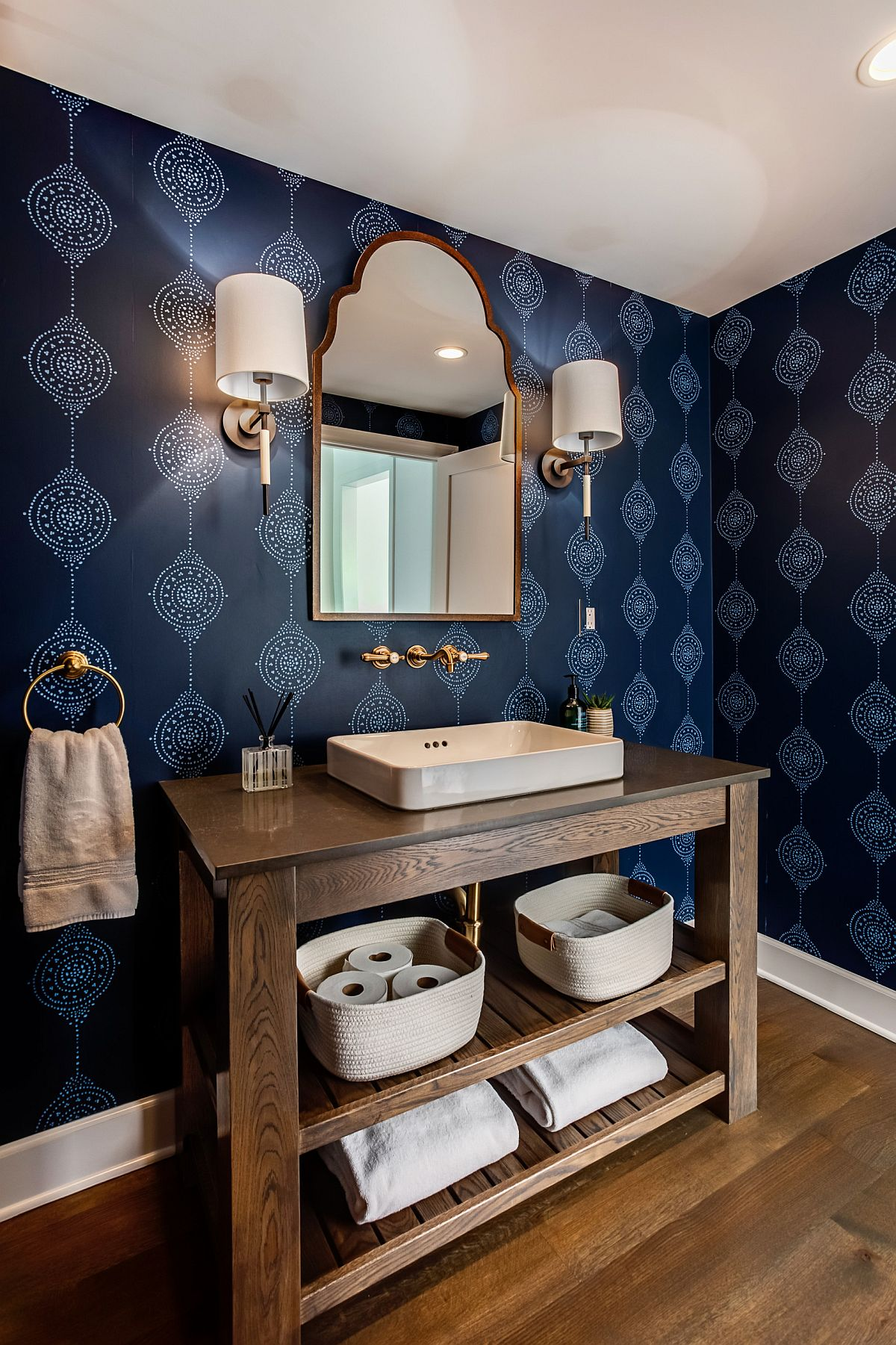 Gorgeous wallpaper in blue brings both color and pattern to this modern farmhouse powder room