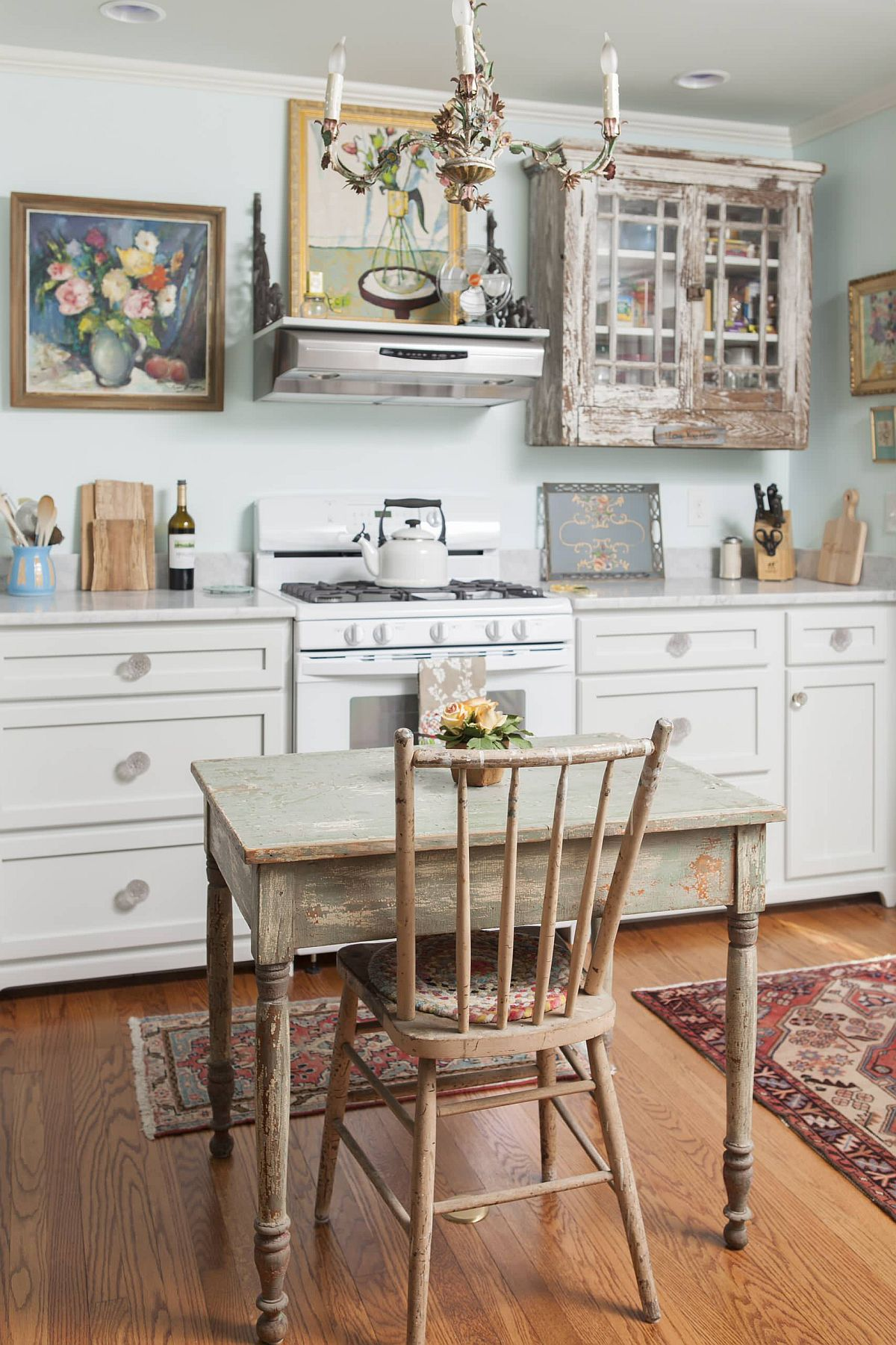 Gorgeous shabby chic kitchen where artwork brings flowery charm to the setting