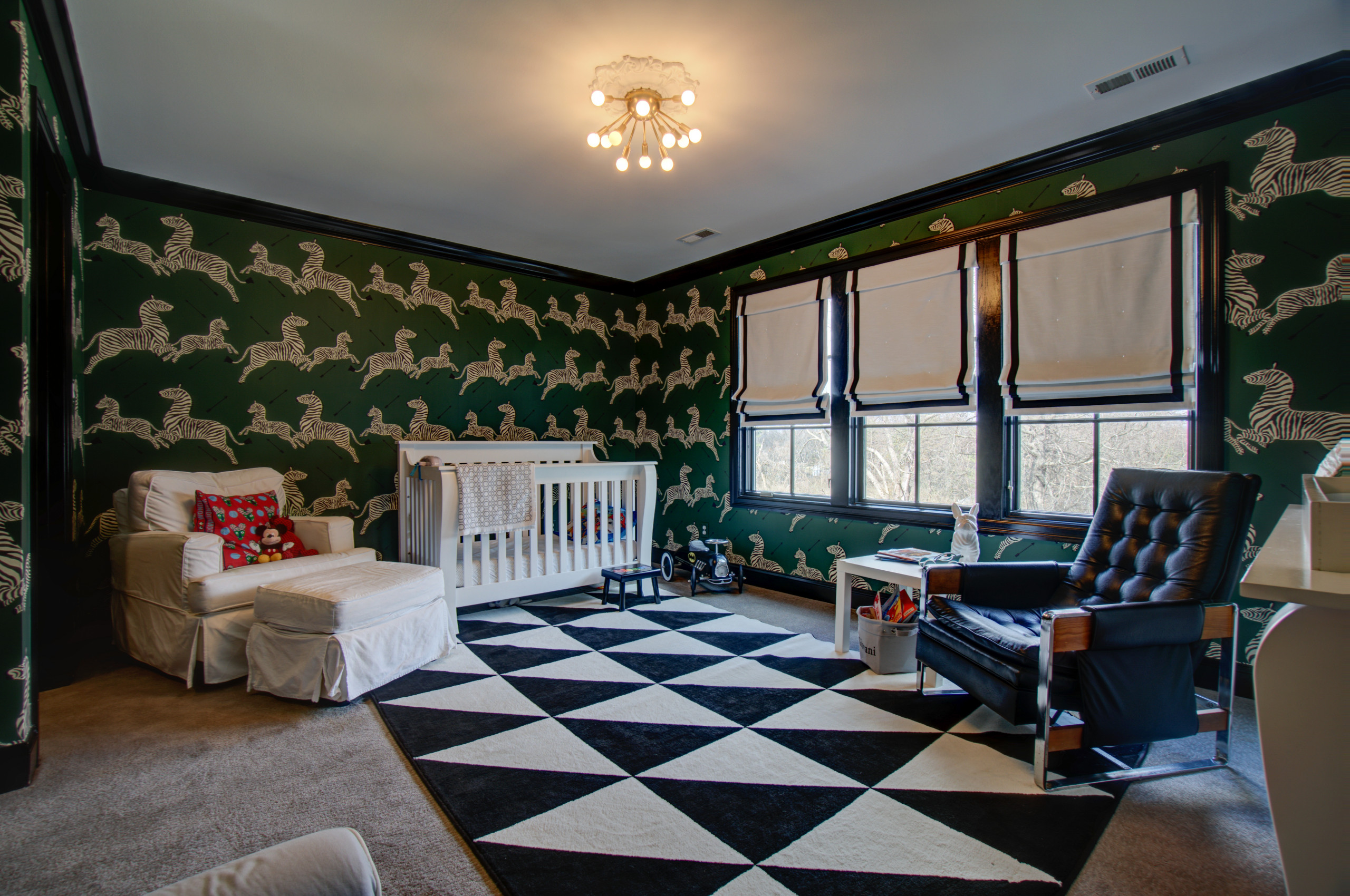 Gorgeous wallpaper in green with pattern that adds cheer to the lovely nursery